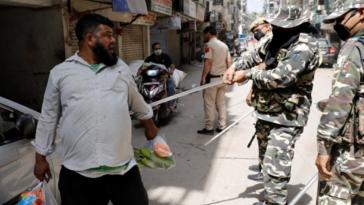 polícia índia quarentena coronavírus